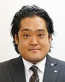 スーツの男性小林氏