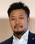 スーツの男性熊沢氏