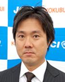 スーツの男性小坂氏